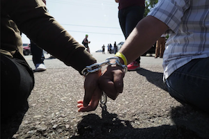 Two children's hands chained together